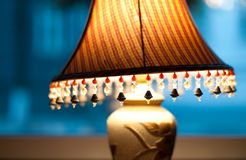 Classic lamp with dim light near window. Royalty Free Stock Image