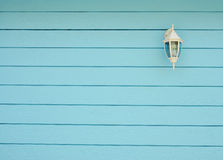 Classic lamp mounted on wooden wall Stock Photo