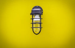 Classic lamp on surface yellow wall Stock Images