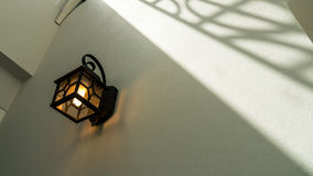 A CLASSIC LAMP ON THE WALL Stock Images