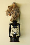 Classic lantern. A classic lantern hanged on a piece of wood Royalty Free Stock Photography