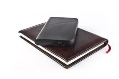 Classic leather book and modern portable hard driv Stock Photos