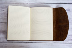 Classic Leather Bound Journal Book Fully Open on a White Barn Board Floor Royalty Free Stock Images