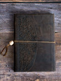Classic Leather Bound Journal Book on a Old Barn Board Floor Straight On Royalty Free Stock Images