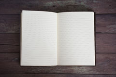 Classic Leather Bound Journal Book Open on a Old Barn Board Floor Stock Photography