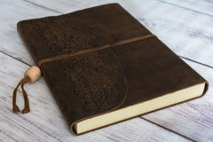 Classic Leather Bound Journal Book on a White Barn Board Floor Close Up Stock Photo