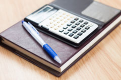 Classic leather notebook with pen and calculator Stock Photo