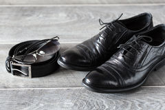 Classic leather shoes, belt and sunglasses Royalty Free Stock Image