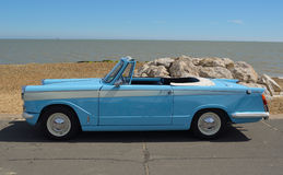 Classic light Blue Triumph Herald open top motor car. Royalty Free Stock Images