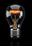 Classic light bulb on dark background. Classic glowing light bulb on black background. 3d rendering Stock Image