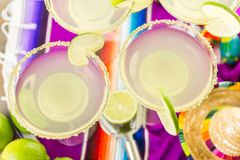 Lime margarita. Classic lime margarita with garnish lime and turbinado sugar for Fiesta Stock Photography