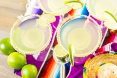 Lime margarita. Classic lime margarita with garnish lime and turbinado sugar for Fiesta Stock Image