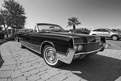 Classic Lincoln Convertible Car. Classic black Lincoln Continental convertible automobile from Ford Motor Company in black and white. This car has lines similar Stock Images