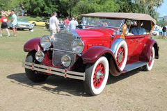 Antique american luxury car driven Stock Photography