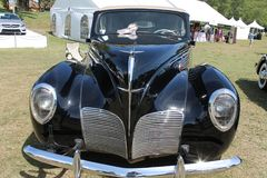Classic Lincoln luxury car on field Royalty Free Stock Images