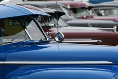 Classic lineup. Photograph of a row of classic cars in mint condition, shining chrome and highly polished finish Stock Photography