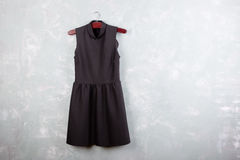 Classic little black ladies dress on the wall Royalty Free Stock Photography