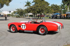 Classic little red sports car. Vintage red Shelby Cobra at Tropical Park Car show, Miami, Florida 2015 Royalty Free Stock Image