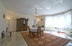 Classic living room. Interior of an elegant, classic living room with the table in the centre, big window and door leading to the garden Stock Photo
