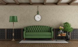 Classic living room with green sofa. And upholstery boiserie - 3d rendering Stock Image