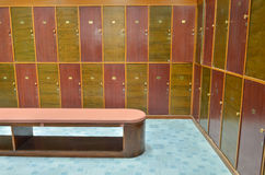 Classic locker room and a bench royalty free stock photos