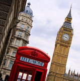 Classic London. Traditional red English telephone box with the Tower of Big Ben Royalty Free Stock Photography