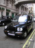 Classic London Cab. On the street royalty free stock photography