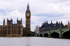 Classic London view. View of Big Ben and Westminster Bridge from across the River Thames Royalty Free Stock Images