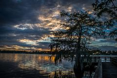 Cloudy sky and sunset at Lake Bruin. Classic Louisiana sunset scene showing cloudy sky and sunset at Lake Bruin Royalty Free Stock Photos