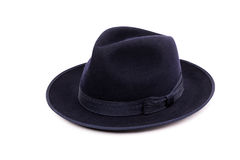 A classic low crown fedora hat in a dark blue color. Stock Image