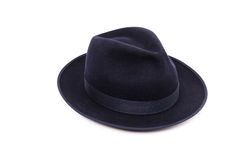 A classic low crown fedora hat in a dark blue color. Stock Photography