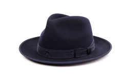 A classic low crown fedora hat in a dark blue color. Stock Photo