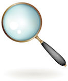Classic magnifying glass Stock Photography