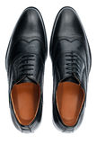 Classic male black leather shoes isolated on a white Royalty Free Stock Photography