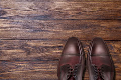 Classic male brown leather shoes on wood Royalty Free Stock Photography
