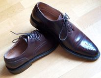 Classic male shoes. Over wood floor Royalty Free Stock Images