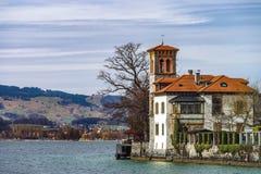 Classic manor on the lake Thun near Oberhofen castle Stock Photography