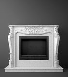 Fireplace. Classic marble fireplace standing against dark gray wall Stock Images