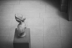 Classic marble sculpture alone in lobby Stock Photography