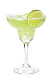 Classic margarita cocktail with lime slice and salty rim. Isolated on white background Stock Images