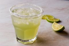 Classic Margarita Cocktail in Salted Glass with Lime and Crushed. Ice. Beverage Concept Royalty Free Stock Photo