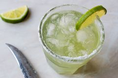 Classic Margarita Cocktail in Salted Glass with Lime and Crushed ice. Beverage Concept Stock Photos