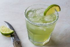 Classic Margarita Cocktail in Salted Glass with Lime and Crushed ice. Beverage Concept Royalty Free Stock Photo