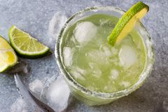 Classic Margarita Cocktail in Salted Glass with Lime and Crushed ice. Beverage Concept Royalty Free Stock Photos