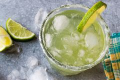 Classic Margarita Cocktail in Salted Glass with Lime and Crushed ice. Beverage Concept Royalty Free Stock Photography