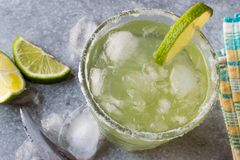 Classic Margarita Cocktail in Salted Glass with Lime and Crushed ice. Beverage Concept Royalty Free Stock Image