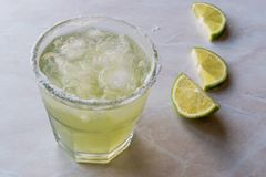 Classic Margarita Cocktail in Salted Glass with Lime and Crushed ice. Beverage Concept Stock Photography