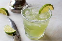 Classic Margarita Cocktail in Salted Glass with Lime and Crushed ice. Beverage Concept Stock Photo