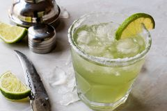 Classic Margarita Cocktail in Salted Glass with Lime and Crushed ice. Beverage Concept Stock Image