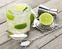 Classic margarita cocktail with salty rim on wooden table royalty free stock image
